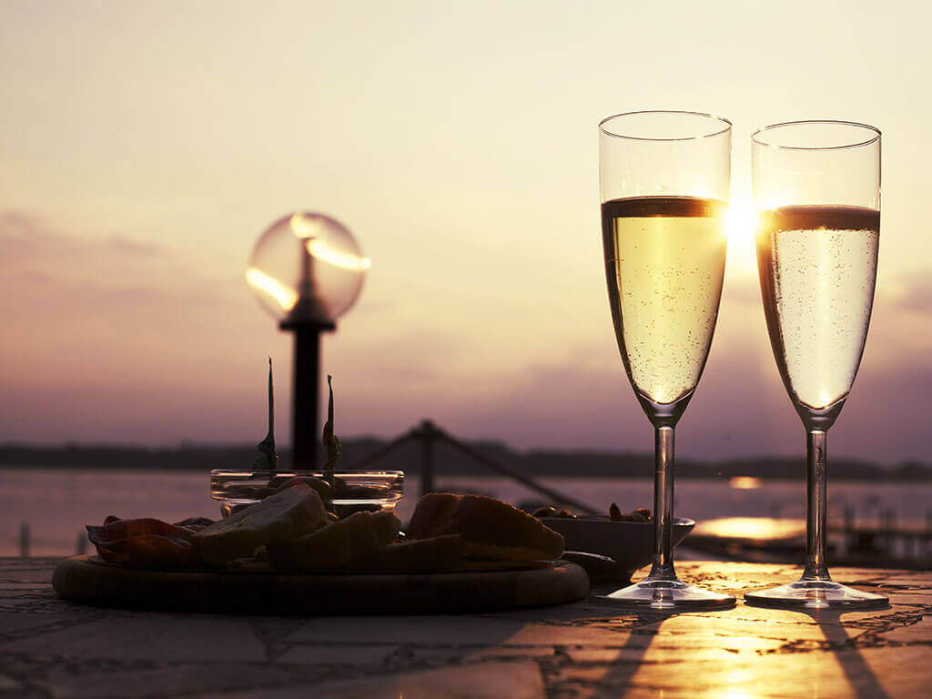 Image of Picture of Two Glasses Of Wine In Sunset